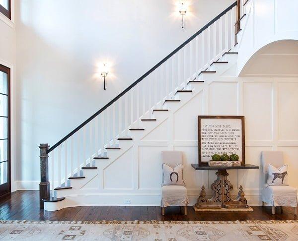 You have to see this #farmhouse decor idea with dark hardwood floor and startling innovative foyer table. Love it! #FarmhouseDecor #HomeDecorIdeas