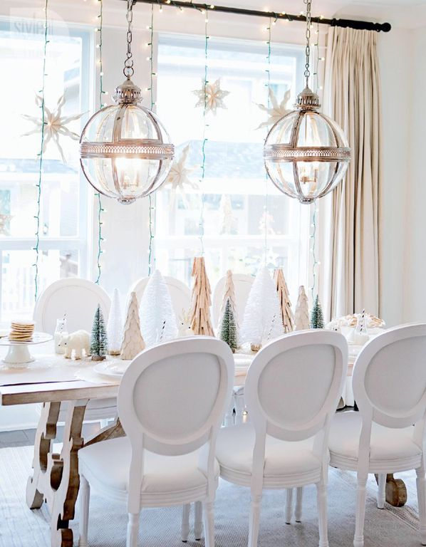 decor idea with futuristic chandeliers and massive hardwood dining table. Love it!