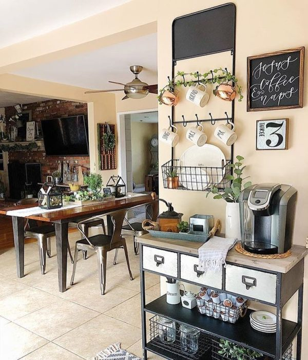 You have to see this #farmhouse decor idea with vintage ceiling fan and hanging metal storage racks. Love it! #FarmhouseDecor #HomeDecorIdeas