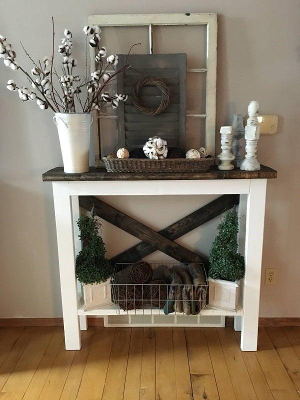 You have to see this #farmhouse decor idea with metal storage basket, a tin vase and contrasting mix of floral decor. Love it! #FarmhouseDecor #HomeDecorIdeas