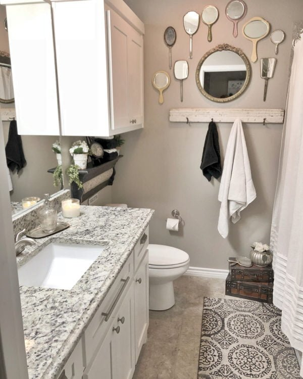 decor idea with a wood plank hanger and a white bathroom cabinet. Love it!