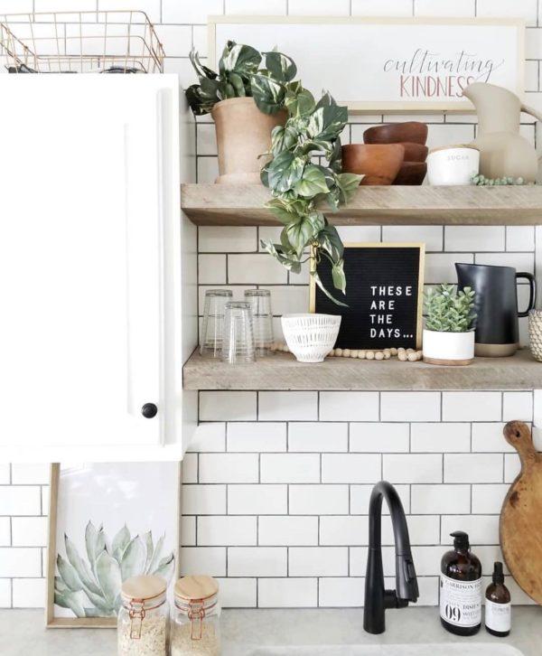You have to see this #farmhouse decor idea with a black iron faucet and metal-ceramic decorative elements. Love it! #FarmhouseDecor #HomeDecorIdeas