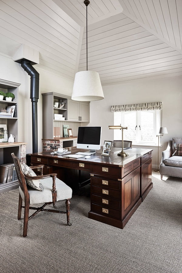 100 Charming Farmhouse Decor Ideas for Your Home Office - The pyramid-like white plank walls play extraordinarily with the double joint hardwood office desk and old-age stove transformed into a book shelf and cabinet space.