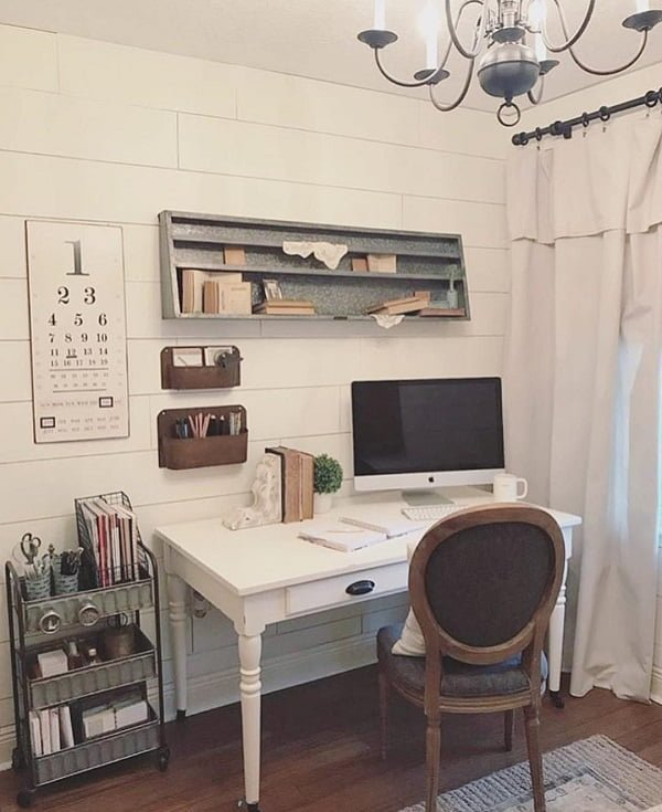 100 Charming Farmhouse Decor Ideas for Your Home Office - You have to see this #farmhouseoffice decor idea with single white wood desk and dark hardwood floors. Love it! #FarmhouseOfficeDecor #HomeDecorIdeas