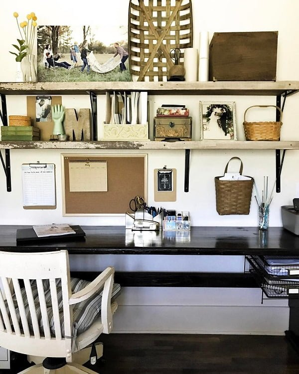 100 Charming Farmhouse Decor Ideas for Your Home Office - You have to see this #farmhouseoffice decor idea with white padded retro chair and timber decorative details. Love it! #FarmhouseOfficeDecor #HomeDecorIdeas