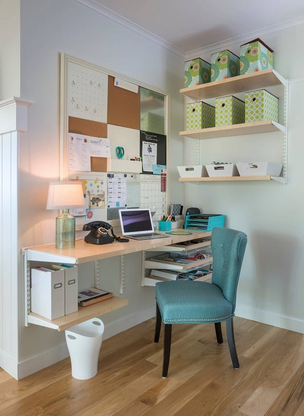 100 Charming Farmhouse Decor Ideas for Your Home Office - You have to see this #farmhouseoffice decor idea with luxurious turquoise chair and large hanging cork board. Love it! #FarmhouseOfficeDecor #HomeDecorIdeas