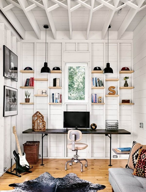 100 Charming Farmhouse Decor Ideas for Your Home Office - You have to see this #farmhouseoffice decor idea with in-built wood shelves and comfortable grey couch. Love it! #FarmhouseOfficeDecor #HomeDecorIdeas
