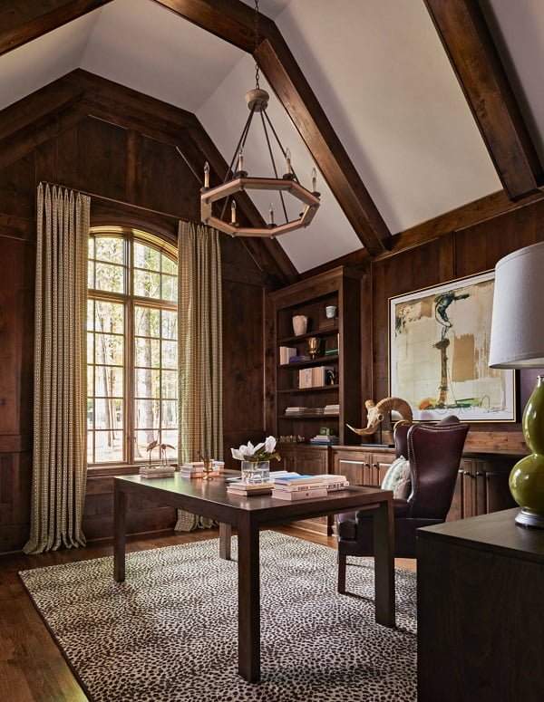 100 Charming Farmhouse Decor Ideas for Your Home Office - You have to see this #farmhouseoffice decor idea with freestanding wood desk and leather burgundy armchair. Love it! #FarmhouseOfficeDecor #HomeDecorIdeas