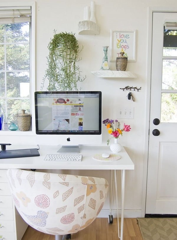 100 Charming Farmhouse Decor Ideas for Your Home Office - You have to see this #farmhouseoffice decor idea with cream leather office chair and across-the-room book shelf. Love it! #FarmhouseOfficeDecor #HomeDecorIdeas