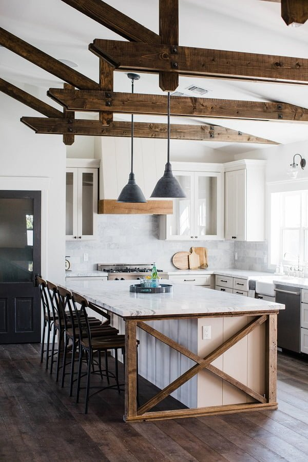 You have to see this #farmhousekitchen decor idea with glass-wood cabinets and wood ceiling bars. Love it! #FarmhouseKitchen #HomeDecorIdeas