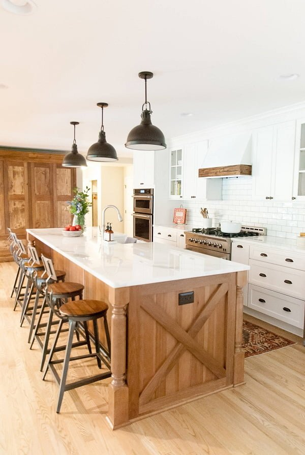 You have to see this #farmhousekitchen decor idea with hardwood floors and cabinets and a sliding barn door. Love it! #FarmhouseKitchen #HomeDecorIdeas