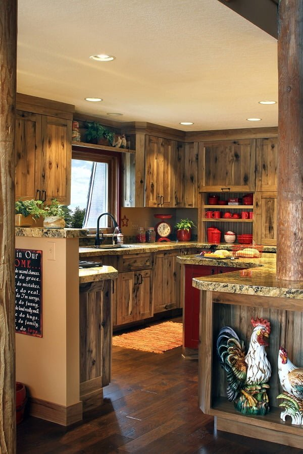 You have to see this #farmhousekitchen decor idea with marble countertops and a red statement cabinet. Love it! #FarmhouseKitchen #HomeDecorIdeas