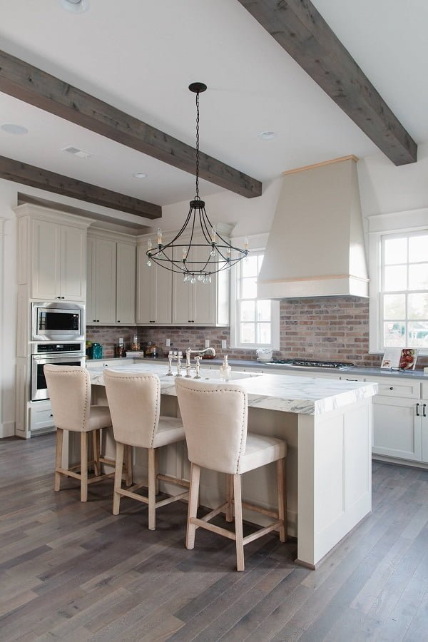100 Stunning Farmhouse Kitchen Decor Ideas You Have to Try - You have to see this #farmhousekitchen decor idea with statement marbe dining room and a brick fireplace. Love it! #FarmhouseKitchen #HomeDecorIdeas
