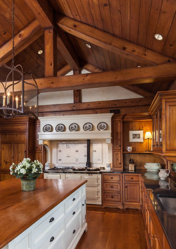 100 Stunning Farmhouse Kitchen Decor Ideas You Have to Try - You have to see this #farmhousekitchen decor idea with iron-glass chandelier and high wood-bar ceiling. Love it! #FarmhouseKitchen #HomeDecorIdeas