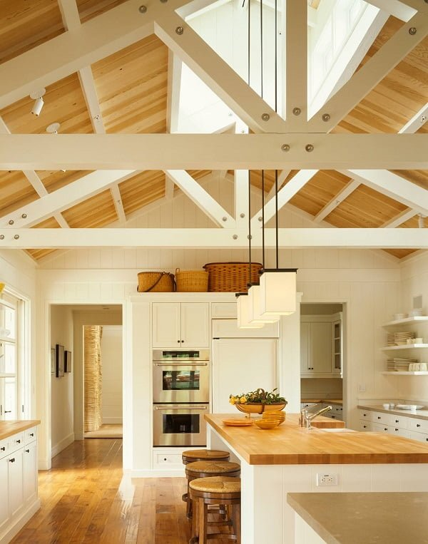 You have to see this #farmhousekitchen decor idea with hardwood floors and three discrete and hanging ceiling lights. Love it! #FarmhouseKitchen #HomeDecorIdeas