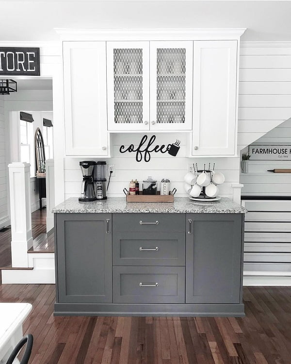 You have to see this #farmhousekitchen decor idea with practical cup hanger and almost transparent wall cabinets. Love it! #FarmhouseKitchen #HomeDecorIdeas