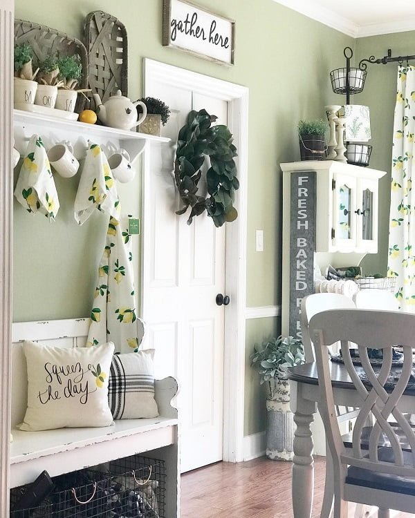 You have to see this #farmhousekitchen decor idea with white entertaining signs and rustic glassdoor cabinet. Love it! #FarmhouseKitchen #HomeDecorIdeas