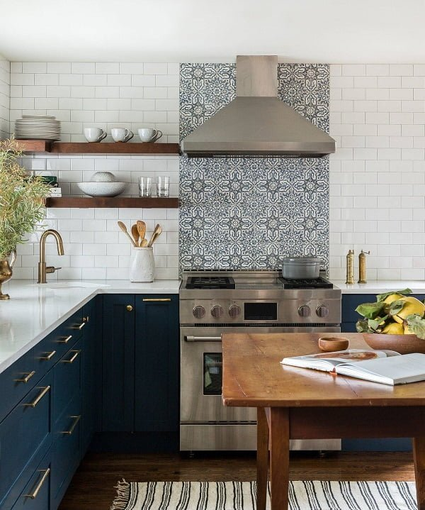 You have to see this #farmhousekitchen decor idea with white tile walls and traditional kitchen table. Love it! #FarmhouseKitchen #HomeDecorIdeas