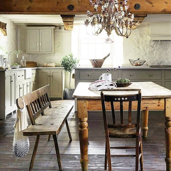 You have to see this #farmhousekitchen decor idea with low, wood bars ceiling and dark hardwood floors. Love it! #FarmhouseKitchen #HomeDecorIdeas