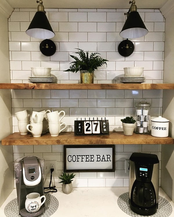 You have to see this #farmhousekitchen decor idea with bar lamps and adorable wall signs. Love it! #FarmhouseKitchen #HomeDecorIdeas