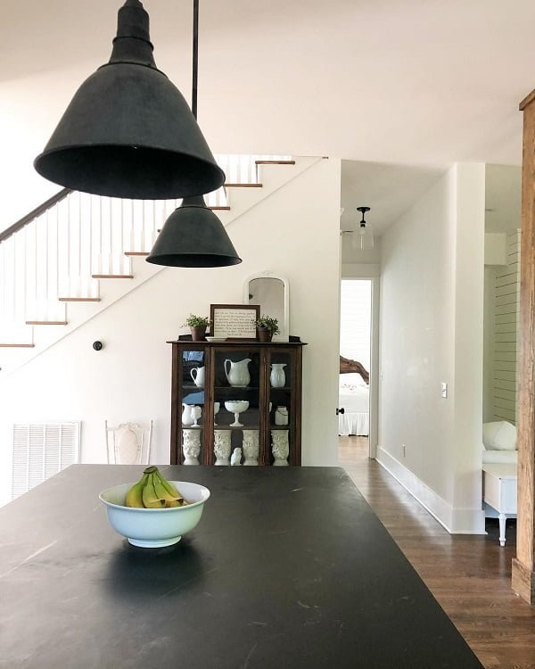 You have to see this #farmhousekitchen decor idea with hardwood floors and no-door hallways. Love it! #FarmhouseKitchen #HomeDecorIdeas