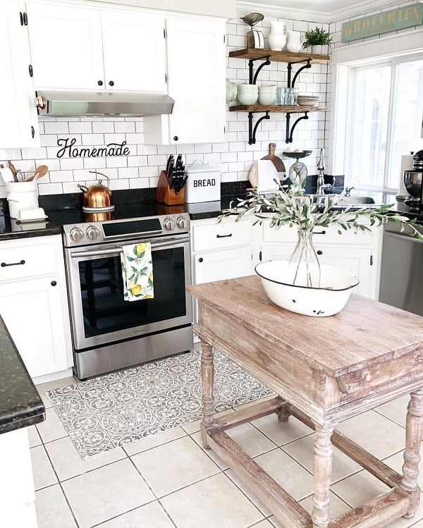 You have to see this #farmhousekitchen decor idea with hadrwood shelves and white brick walls. Love it! #FarmhouseKitchen #HomeDecorIdeas