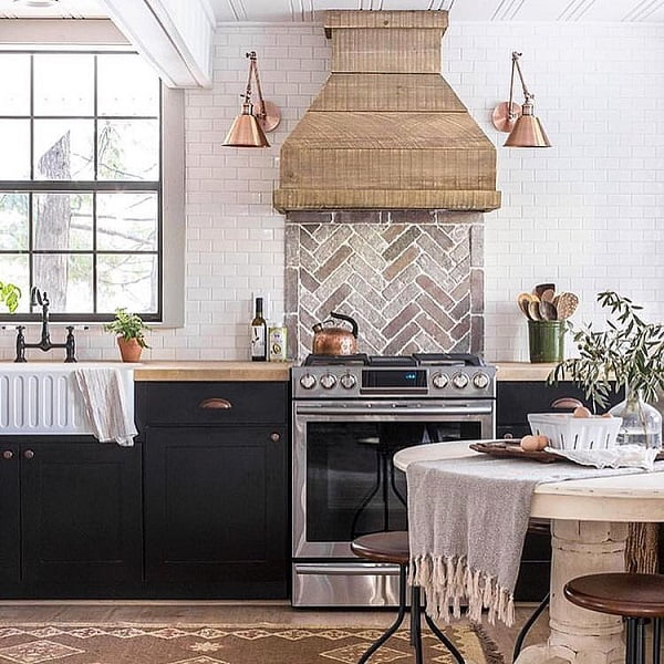 You have to see this #farmhousekitchen decor idea with round dining table and white butler sink. Love it! #FarmhouseKitchen #HomeDecorIdeas