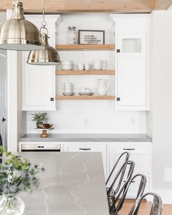 100 Stunning Farmhouse Kitchen Decor Ideas You Have to Try - You have to see this kitchen decor idea with mettalic bar chairs and brass bar ceiling lamps. Love it! Kitchen