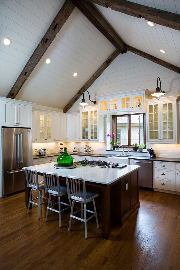 You have to see this #farmhousekitchen decor idea with white medium hardwood countertops and mettalic towel holder. Love it! #FarmhouseKitchen #HomeDecorIdeas