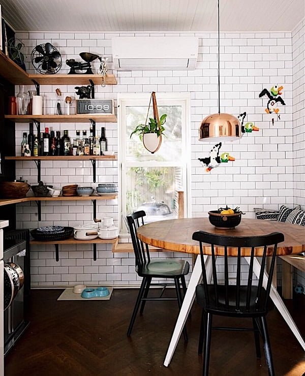 100 Stunning Farmhouse Kitchen Decor Ideas You Have to Try - You have to see this #farmhousekitchen decor idea with corner-placed wall shelves and bronze hanging light. Love it! #FarmhouseKitchen #HomeDecorIdeas