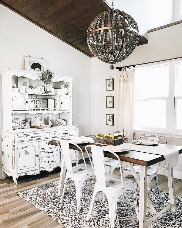 You have to see this #farmhousekitchen decor idea with white, mettalic chairs and matching printed carpet. Love it! #FarmhouseKitchen #HomeDecorIdeas