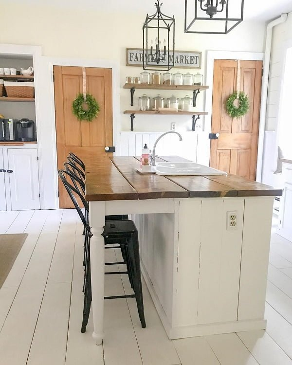 You have to see this #farmhousekitchen decor idea with white plank floors and drop-in sink. Love it! #FarmhouseKitchen #HomeDecorIdeas