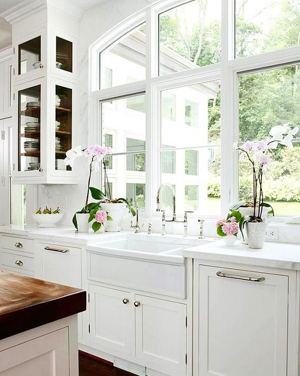 100 Stunning Farmhouse Kitchen Decor Ideas You Have to Try - You have to see this kitchen decor idea with dark countertop table and matching hardwood floors. Love it! Kitchen