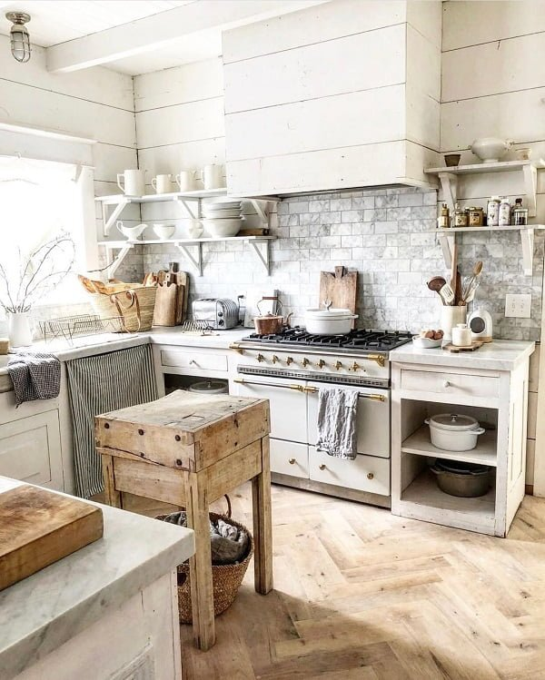 You have to see this #farmhousekitchen decor idea with grey brick-tile walls and open white shelves. Love it! #FarmhouseKitchen #HomeDecorIdeas
