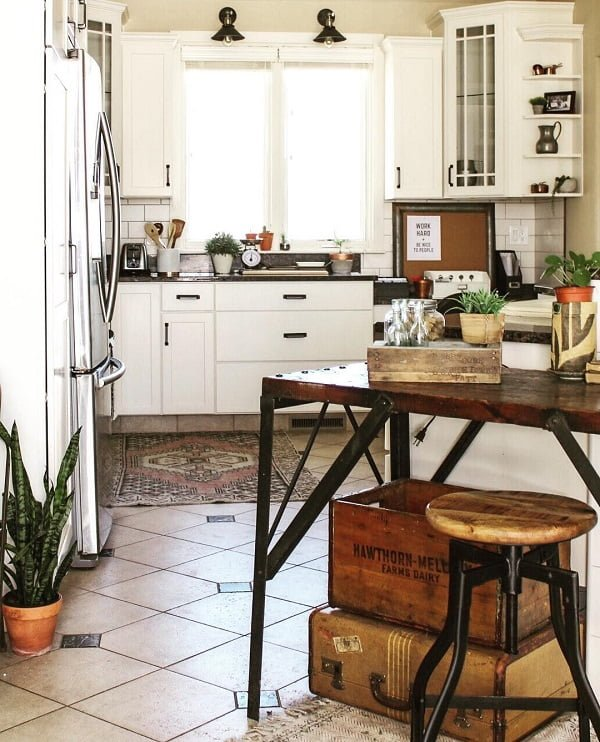You have to see this #farmhousekitchen decor idea with tile floors and corner glassdoor cabinets. Love it! #FarmhouseKitchen #HomeDecorIdeas