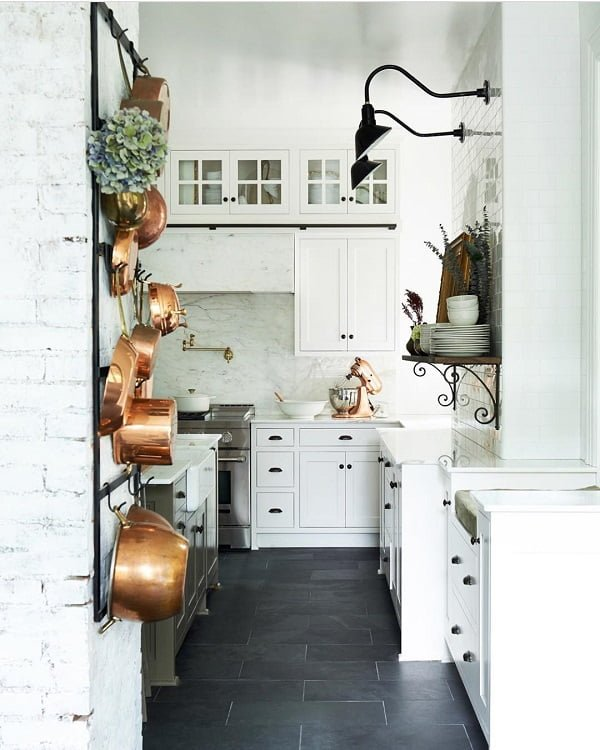 100 Stunning Farmhouse Kitchen Decor Ideas You Have to Try - You have to see this #farmhousekitchen decor idea with built-in trash cans and dark tile floors. Love it! #FarmhouseKitchen #HomeDecorIdeas