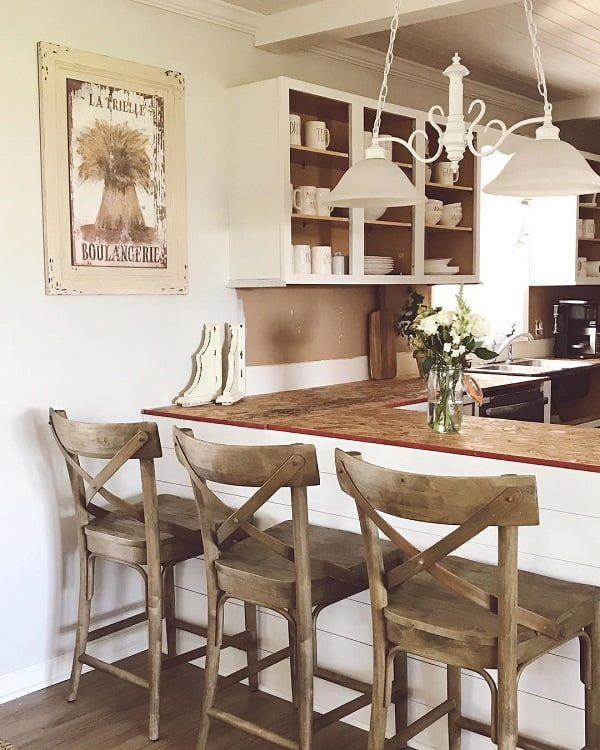 100 Stunning Farmhouse Kitchen Decor Ideas You Have to Try - You have to see this #farmhousekitchen decor idea with open wall cabinets and captivating wall poster. Love it! #FarmhouseKitchen #HomeDecorIdeas