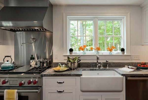 100 Inspiring Farmhouse Sink Ideas for the Kitchen and Bathroom - You have to see this sink decor idea with grey countertops and detached silver faucet. Love it!