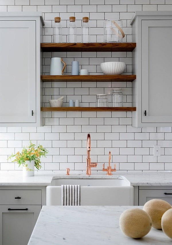 100 Inspiring Farmhouse Sink Ideas for the Kitchen and Bathroom - You have to see this sink decor idea with an intelligent towel holder and copper faucet. Love it!