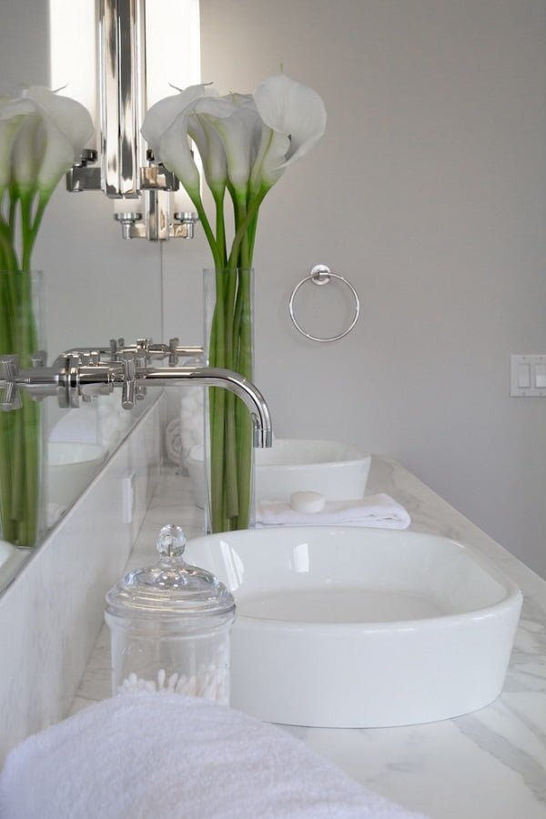 100 Inspiring Farmhouse Sink Ideas for the Kitchen and Bathroom - You have to see this sink decor idea with mirror installed silver faucets, and a fancy soap holder. Love it!