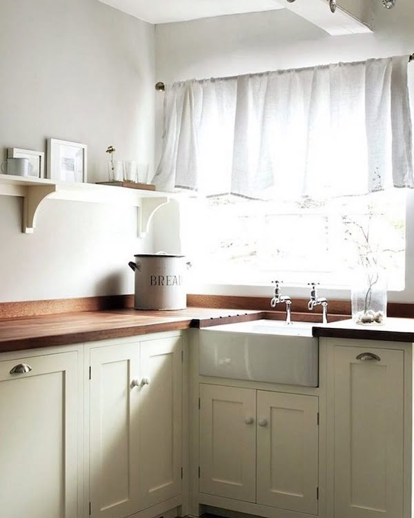 100 Inspiring Farmhouse Sink Ideas for the Kitchen and Bathroom - You have to see this #farmhousesink decor idea with double bibcock taps and protective hardwood countertop frame. Love it! #FarmhouseSinkDecor #HomeDecorIdeas