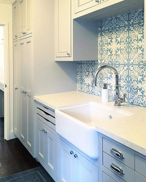 100 Inspiring Farmhouse Sink Ideas for the Kitchen and Bathroom - You have to see this sink decor idea with pull down silver faucet and exposed ceramic front. Love it!