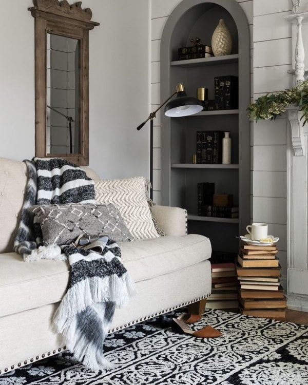 living room decor idea with an inside window overlooking the kitchen and black and white furniture palette . Love it!