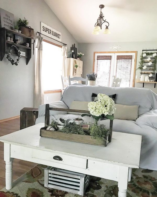 living room decor idea with a rustic nightstand and floral arrangements. Love it!