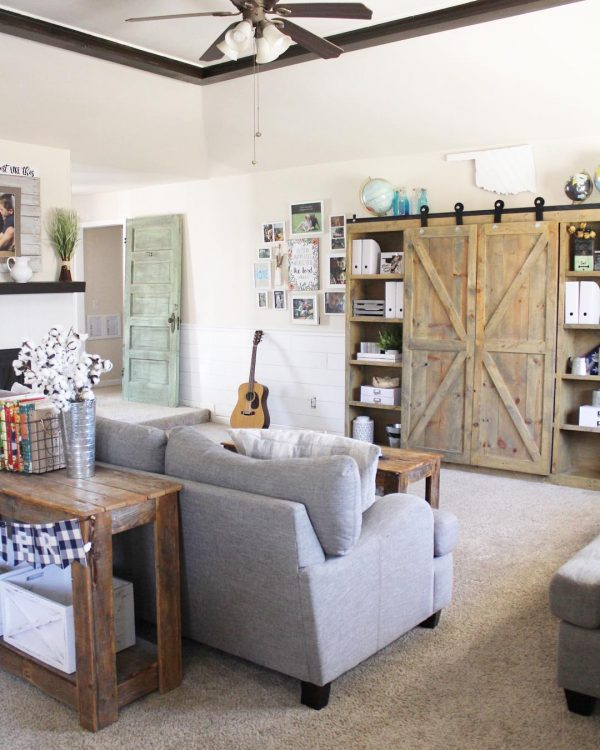 living room decor idea with a wooden sliding door closet and a traveler's favorite souvenirs. Love it!