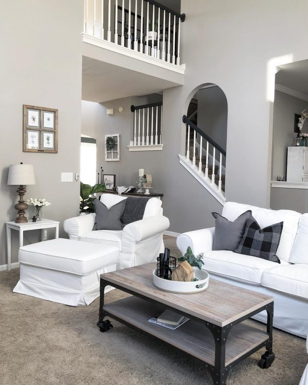 living room decor idea with secluded staircase and mobile wooden coffee table. Love it!