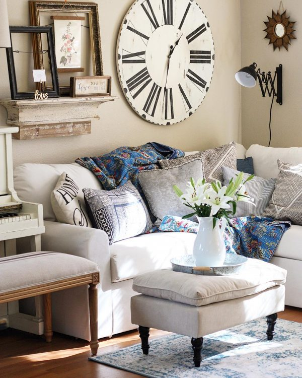 living room decor idea with attention-grabbing wall clock and comfortable sofa. Love it!