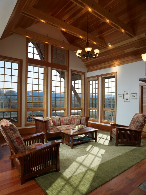 living room decor idea with incredible glass block windows and porch-inspired furnishing set. Love it!