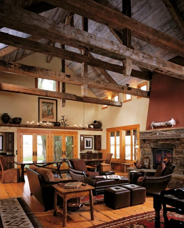 living room decor idea with dark wooden tones and majestic stone fireplace. Love it!