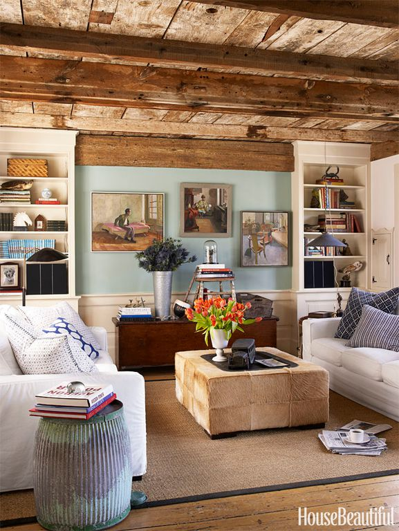 living room decor idea with hippie details and painting-packed walls. Love it!